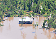The mighty  Mississippi River floods the rich delta farm lands and threatens to overtop the levees. The river is at its highest levels in over 100 years and is not expected to crest in Clarksdale to at least Wednesday May 11, and Vicksburg Mississippi, further down river will experience its highest flood levels in 100 years. The Mississippi River flooding is devastating hundreds of thousands of acres of land, homes and lives. Aerial photos illustrate the flooding due west of Clarksdale Mississippi and south of the Helena Arkansa River Bridge. Photo©SuziAltman.com The mighty  Mississippi River floods the rich delta farm lands and threatens to overtop the levees. The river is at its highest levels in over 100 years and is not expected to crest in Clarksdale to at least Wednesday May 11, and Vicksburg Mississippi, further down river will experience its highest flood levels in 100 years. The Mississippi River flooding is devastating hundreds of thousands of acres of land, homes and lives. Aerial photos illustrate the flooding due west of Clarksdale Mississippi and south of the Helena Arkansa River Bridge Sunday May 11,2011.Photo©SuziAltman.com