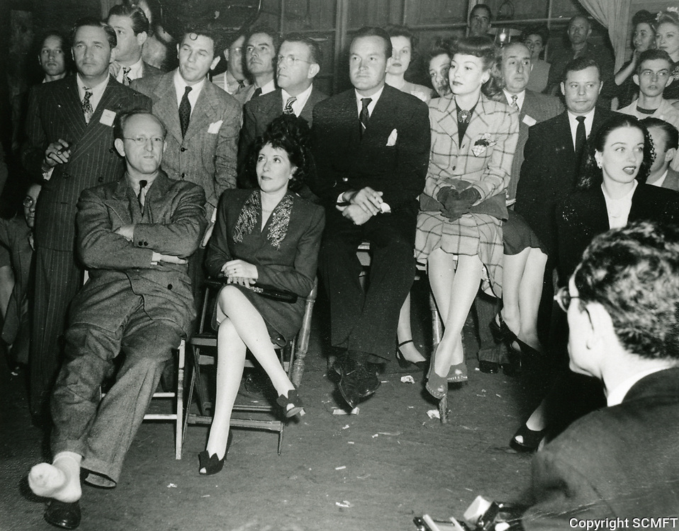 1943 L to R: Mervin LeRoy, Kay Keyser, John Garfield, Gracie Allen, George Burns, Bob Hope, Jane Wyman, unknown man, Hedy Lamarr during Hollywood Canteen's 1st Anniversary party