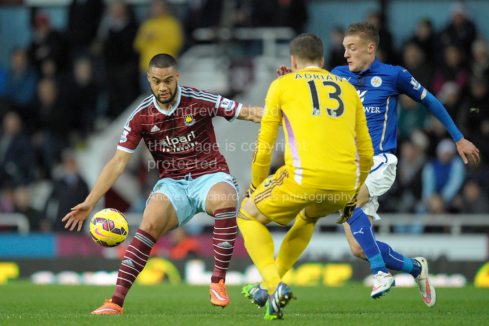 Winston Reid of West Ham United blocking Jamie Vardy of Leicester City for Goalkeeper Adrian of West Ham United to collect the ball. Barclays Premier league match, West Ham Utd v Leicester city at the Boleyn ground, Upton Park in London on Sat 20th December 2014.<br /> pic by John Patrick Fletcher, Andrew Orchard sports photography.