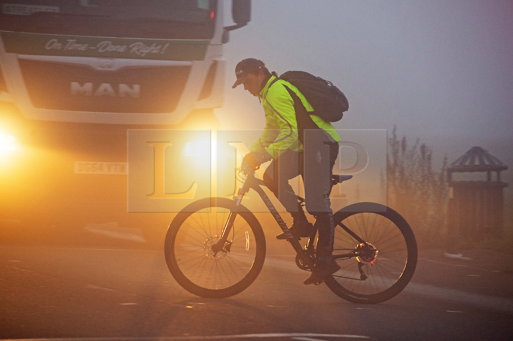 © Licensed to London News Pictures. 27/11/2020. <br /> Blackheath, UK. A cyclist braving the cold fog on Blackheath Common, London. Freezing foggy weather conditions this Friday morning across large parts of the UK. Photo credit:Grant Falvey/LNP