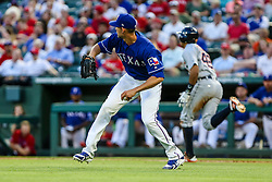 May 8, 2018 - Arlington, TX, U.S. - ARLINGTON, TX - MAY 08: Texas Rangers starting pitcher Mike Minor (36) goes for a bunt and turns to throw to first base during the game between the Texas Rangers and the Detroit Tigers on May 08, 2018 at Globe Life Park in Arlington, Texas. Detroit defeats Texas 7-4. (Photo by Matthew Pearce/Icon Sportswire) (Credit Image: © Matthew Pearce/Icon SMI via ZUMA Press)