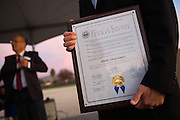 MUSD Superintendent Cary Matsuoka holds onto the Board of Supervisors Commendation plaque during the Milpitas Unified School District and San Jose Evergreen Community College District Community College Extension Ground Breaking Ceremony near Russell Middle School in Milpitas, California, on November 17, 2015. (Stan Olszewski/SOSKIphoto)