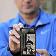 Duke head coach Mike Krzyzewski holds up a photo of his good friend, Jim Valvano, at ESPN's studio in Charlotte, N.C. The portrait is being used for a campaign for the V Foundation for Cancer Research.  Photo by Travis Bell ©Travis Bell Photography