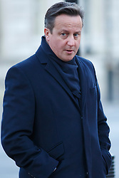 © licensed to London News Pictures. London, UK 14/01/2014. Prime minister David Cameron taking his daughter Florence (not pictured) to nursery before a cabinet meeting on Downing Street on Tuesday, 14 January 2014. Photo credit: Tolga Akmen/LNP