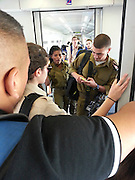 Tel Aviv Hahagana station. Soldiers inside the train