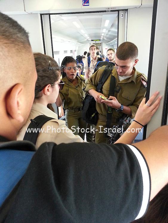 Tel Aviv Hahagana station. Soldiers inside the train