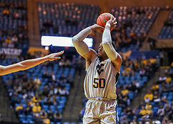 Dec 1, 2018; Morgantown, WV, USA; West Virginia Mountaineers forward Sagaba Konate (50) shoots a three pointer during the second half against the Youngstown State Penguins at WVU Coliseum. Mandatory Credit: Ben Queen-USA TODAY Sports