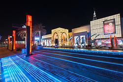 Night view of exterior of Dubai Mall, the world's largest, in Dubai United Arab Emirates