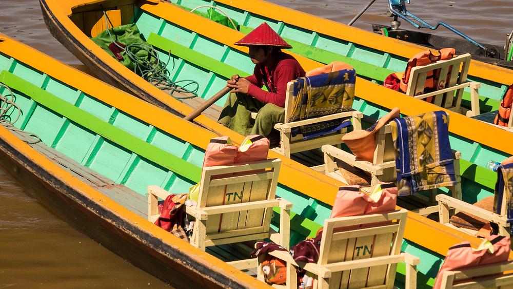 Colorful traditional boats and driver at Nan Pan, Inle Lake, Myanmar