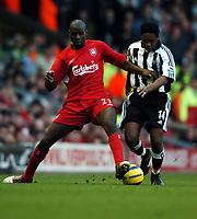 Fotball<br /> Premier League 2004/05<br /> Liverpool v Newcastle<br /> 19. desember 2004<br /> Foto: Digitalsport<br /> NORWAY ONLY<br /> Djimi Traore<br /> Liverpool 2004/05<br /> Charles N'Zogbia Newcastle United