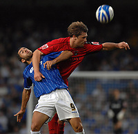 Photo: Ashley Pickering.<br /> Ipswich Town v Coventry City. Coca Cola Championship. 22/09/2007.<br /> Pablo Counago of Ipswich (L) and Arjan De Zeeuw of Coventry