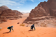 Yoesun Lim (left) and SeongRyeong Bak play on a red sand dune in Wadi Rum, Jordan.