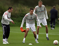 Photo: Paul Thomas.<br /> England Training. 06/10/2006.<br /> <br /> Wayne Rooney, Michael Carrick and Peter Crouch.