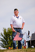 29 AUGUST 2020 - RUNNELLS, IOWA: A veteran at the funeral for Pvt. Roy Brown Jr. in Runnells, IA. Pvt. Brown was a US Army soldier in World War II. He was an infantryman in the 126th Infantry Regiment, 32nd Infantry Division, serving in the Australian Territory of Papua (now Papua New Guinea). He went missing in action on Dec. 2, 1942. Unidentified remains were recovered on Feb. 2, 1943 and were eventually interred in the Manila American Cemetery. On May 14, 2019, Defense POW/MIA Accounting Agency using dental records, circumstantial evidence and DNA identified the remains as Pvt. Brown's. He was reinterred in the Lowman Cemetery in Runnells Saturday.     PHOTO BY JACK KURTZ