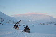 UNIS students drive snowmobiles through Helvetiadalen on a class field trip to Tellbreen, Svalbard.