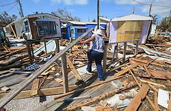 Mirta Mendez walks through the debris at the Seabreeze trailer park along the Overseas Highway in the Florida Keys on Tuesday, September 12, 2017. Photo by Al Diaz/Miami Herald/TNS/ABACAPRESS.COM