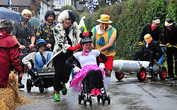 © Licensed to London News Pictures.01/01/2018<br /> SUTTON VALENCE, UK.<br /> MICKEY MOUSE TEAM AT THE START.  FINISHED 4TH.<br /> The traditional New Years day Sutton Valence Pram Race in Kent continued this year. In its 38th year the Race was struck by tragedy last year when competitor Francis 'Titch' O' Sullivan tipped over in his spitfire pram and hit his head on the curb, he passed away a day later. A coroners court reported he was not wearing a helmet.<br />  All babies in the pram's have to wear a helmet and the pushers must have contact with the pram and the ground at all times.<br />  <br /> Photo credit: Grant Falvey/LNP