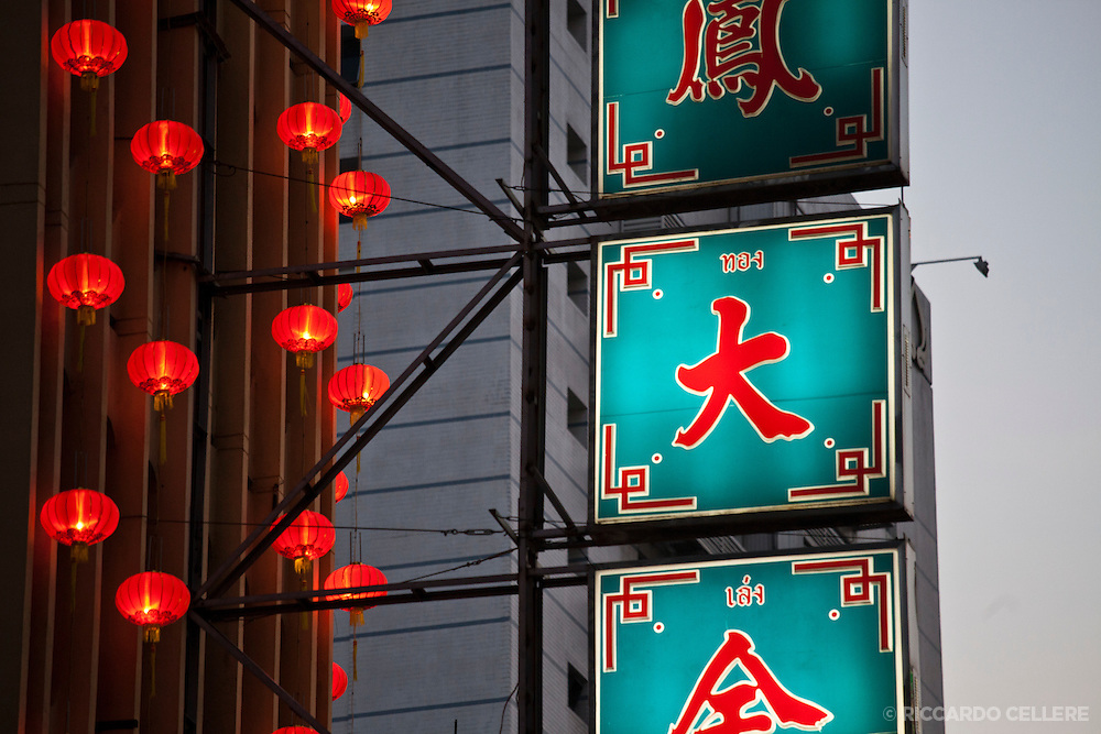 Brightly lit signs and lanterns in Bangkok's Chinatown