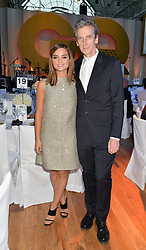 JENNA COLEMAN and PETER CAPALDI at the GQ Men Of The Year 2014 Awards in association with Hugo Boss held at The Royal Opera House, London on 2nd September 2014.