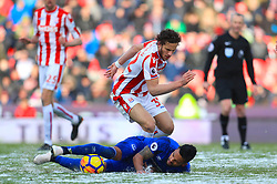Everton's Theo Walcott and Stoke City's Ramadan Sobhi battle for the ball during the Premier League match at the bet365 Stadium, Stoke.