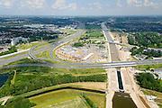 Nederland, Noord-Brabant, Gemeente Den Bosch, 26-06-2014;  aanleg Maximakanaal, directe verbinding tussen de Maas en de Zuid-Willemsvaart. Knooppunt Hintham, A2 - A59. En Sluis Hintham.<br /> Door de omlegging van Zuid-Willemsvaart hoeft de beroepsvaart niet langer door de binnenstad van Den Bosch. Ook maakt het nieuwe kanaal het mogelijk met grotere schepen te varen.<br /> Construction Maxima channel, direct connection between river Meuse river and the South Willemsvaart, East of Den Bosch. <br /> luchtfoto (toeslag op standaard tarieven);<br /> aerial photo (additional fee required);<br /> copyright foto/photo Siebe Swart.