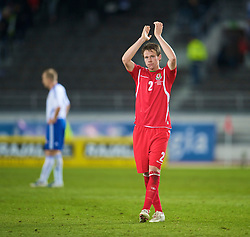 HELSINKI, FINLAND - Saturday, October 10, 2009: Wales' Chris Gunter applauds the travelling supporters after his side's 2-1 defeat by Finland during the 2010 FIFA World Cup Qualifying Group 4 match at the Olympic Stadium. (Pic by David Rawcliffe/Propaganda)