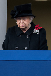 © Licensed to London News Pictures. 12/11/2017. London, UK. HRH QUEEN ELIZABETH II attends a Remembrance Day Ceremony at the Cenotaph war memorial in London, United Kingdom, on November 13, 2016 . Thousands of people honour the war dead by gathering at the iconic memorial to lay wreaths and observe two minutes silence. Photo credit: Ray Tang/LNP