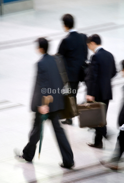 group of businessmen on their way to a meeting