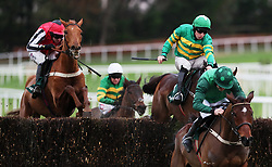 Eventual winner Simply Ned ridden by Mark Walsh (left) clears the last behind Footpad ridden by Ruby Walsh (right) on the way to winning the Paddy's Rewards Club 'Sugar Paddy' Steeplechase during day two of the Leopardstown Christmas Festival at Leopardstown Racecourse.