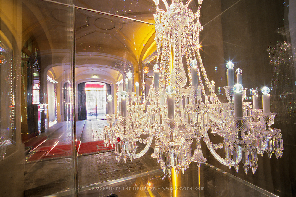 The entrance with the crystal chandelier in a giant aquarium. At The Baccarat museum, shop, restaurant at the Hotel de Noailles in Paris. Designed by Philippe Starck. The Baccarat Museum entrance: a crystal chandelier submerged in a gigantic aquarium