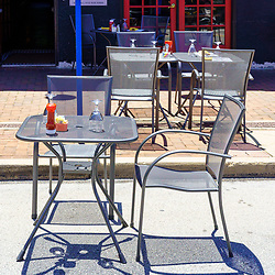Phoenixville, PA, USA - June 14, 2020: Socially distanced tables are appropriately positioned along the main street in the town.