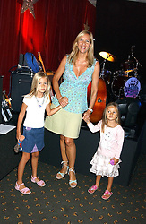 TANIA BRYER and her daughters (L-R) NATASHA & FRANCESCA MOUFFARIGE at a fashion show featuring designs by Diesel Kid's FW05 collection held in The Georgian Restaurant at Harrod's on 1st September 2005.  Proceeds from the event went to the Graet Ormond Street Hospital.<br />