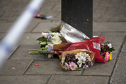 © Licensed to London News Pictures. 03/01/2019. London, UK. Flowers left on the pavement outside the entrance doorway to 80 Park Lane in Mayfair, where security guard Tudor Simionov was stabbed to death in the early hours of New Year's day. The 33-year-old and his colleagues were attacked by a group of men who were trying to gain entry to a party at Fountain House, a £12.5 million townhouse in London's West End.. Photo credit: Ben Cawthra/LNP