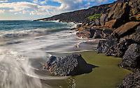 Surf action at Green Sand Beach, also known as Papakolea Beach, Hawaii