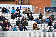 The fans in the stand wearing thick coats on a cold day during the third day of the Specsavers County Champ Div 1 match between Somerset County Cricket Club and Yorkshire County Cricket Club at the Cooper Associates County Ground, Taunton, United Kingdom on 29 April 2018. Picture by Graham Hunt.