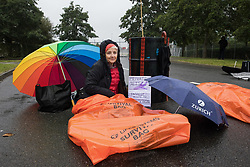 Extinction Rebellion climate activists lie in the road locked to a fuel barrel to block an entrance to Farnborough Airport on 2nd October 2021 in Farnborough, United Kingdom. Activists blocked three entrances to the private airport to highlight elevated carbon dioxide levels produced by super-rich passengers using private jets and 'greenwashing' by the airport in announcing a switch to sustainable aviation fuel (SAF).