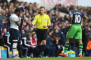 Danny Rose of Tottenham Hotspur (l) reacts to Referee Michael Jones decision  not to book André Ayew of Swansea City ® for his tackle on the Spurs player. Barclays Premier league match, Tottenham Hotspur v Swansea city at White Hart Lane in London on Sunday 28th February 2016.<br /> pic by John Patrick Fletcher, Andrew Orchard sports photography.