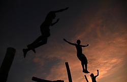 September 1, 2017 - Allahabad, Uttar Pradesh, India - Indian youth play during Sunset at bank of Sangam, bank of River Ganga, Yamuna and mythological Saraswati in Allahabad. (Credit Image: © Prabhat Kumar Verma via ZUMA Wire)