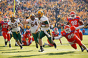 North Dakota State Bison quarterback Brock Jensen (16) carries the ball into the end zone for a touchdown against during the FCS title game against Sam Houston State at FC Dallas Stadium in Frisco, Texas, on January 5, 2013.  (Stan Olszewski/The Dallas Morning News)