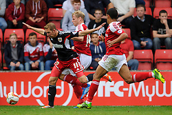Bristol City Midfielder Scott Wagstaff (ENG) is tackled by Swindon Defender James McEveley (SCO) during the second half of the match - Photo mandatory by-line: Rogan Thomson/JMP - Tel: 07966 386802 - 21/09/2013 - SPORT - FOOTBALL - County Ground, Swindon - Swindon Town v Bristol City - Sky Bet League 1.