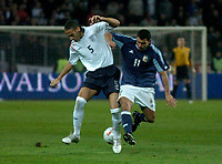 Photo: Glyn Thomas.<br />England v Argentina. International Friendly. 12/11/2005.<br />England's Rio Ferdinand (L) battles for the ball with Carlos Tevez.