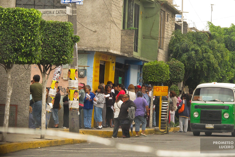 People line waiting to receive money in exchange of their vote for presidential candidate Enrique Peña Nieto, later alleged as winner, in Iztapalapa, east of Mexico City on june 30th, 2012. After numerous complaints on coercion, including a complex delivery of credit cards on supermarkets by Monex and Soriana, the whole presidential electoral process was impugnated by candidate Andrés Manuel López Obrador and pointed as fraudulent by citizens and activists. (Photo: Prometeo Lucero)