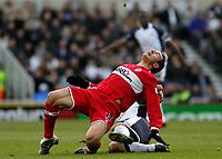 Photo: Andrew Unwin.<br /> Middlesbrough v Tottenham Hotspur. The Barclays Premiership. 18/12/2005.<br /> Tottenham's Andy Reid (R) clatters into Middlesbrough's Doriva (L).