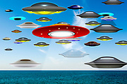 Digitally enhanced image Of Alien invasion. Flying saucers floating over the ocean. The chances of anything coming from Mars are a million to one. But still they come