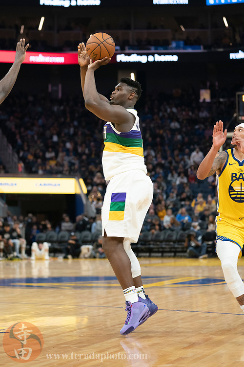 February 23, 2020; San Francisco, California, USA; New Orleans Pelicans forward Zion Williamson (1) shoots the basketball during the third quarter against the Golden State Warriors at Chase Center.