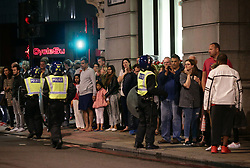 Guests from the Premier Inn Bankside Hotel are evacuated and kept in a group with police on Upper Thames Street following the terrorist incidents on London Bridge and Borough Market.