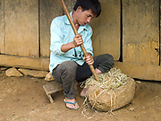 After harvesting and the bark has been peeled off in long thin lengths, the hemp yarn is pounded in large wooden mortar to soften it, Ban Long Kuang, Houaphan province, Lao PDR. Making hemp fabric is a long and laborious process; the end result is a strong durable cloth with qualities similar to linen which the Hmong women use to make their traditional clothing. In Lao PDR, hemp is now only cultivated in remote mountainous areas of the north.