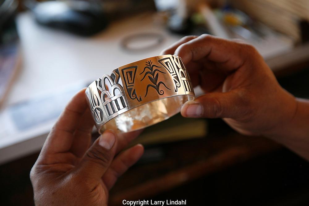 Duane Tawahongva is a Hopi silver overlay jeweler