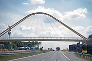 Nicely designed arched supported bridge over the highway. Warsaw Poland