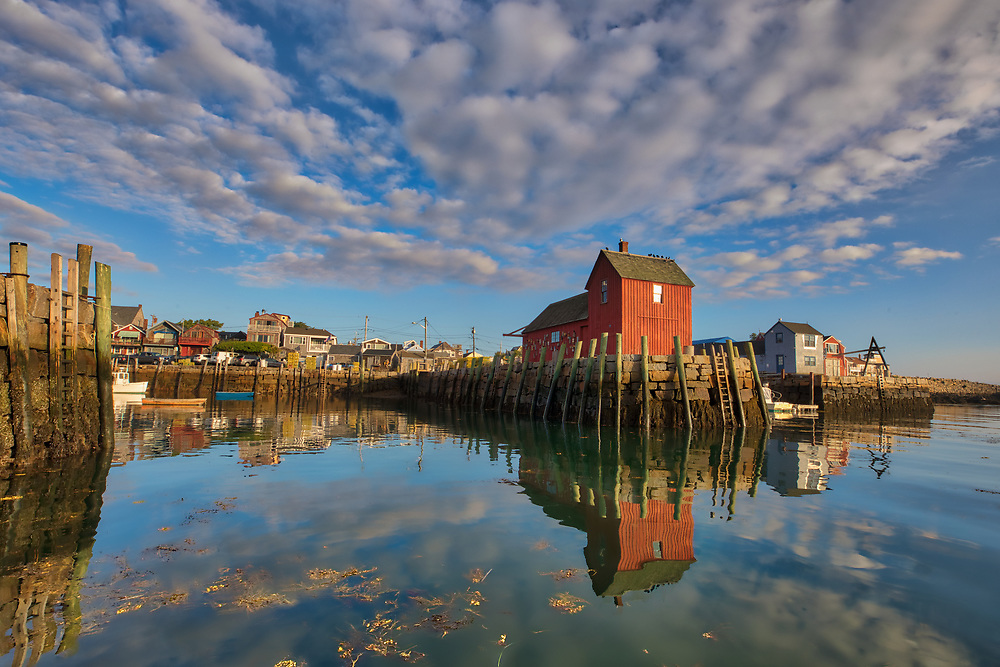 New England sunrise photography of the famous red fishing shack Motif #1 in Rockport, Massachusetts on Cape Ann. The photograph captures the local fishing boats with the iconic landmark and a stunningly beautiful sunrise sky. The historic landmark is known throughout New England as Motif #1, so called because it is the most often painted building in America.<br /> <br /> New England photography images of Rockport Motif Number 1 at sunrise are available as museum quality photography prints, canvas prints, acrylic prints, wood prints or metal prints. Prints may be framed and matted to the individual liking and interior design wall art decorating needs: <br /> <br /> https://juergen-roth.pixels.com/featured/rockport-on-cape-ann-massachusetts-juergen-roth.html<br /> <br /> Good light and happy photo making!<br /> <br /> My best,<br /> <br /> Juergen<br /> Photo Prints & Licensing: http://www.rothgalleries.com<br /> Photo Blog: http://whereintheworldisjuergen.blogspot.com<br /> Instagram: https://www.instagram.com/rothgalleries<br /> Twitter: https://twitter.com/naturefineart<br /> Facebook: https://www.facebook.com